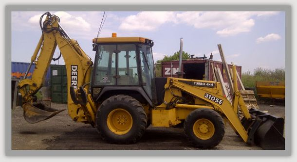 one of our backhoes