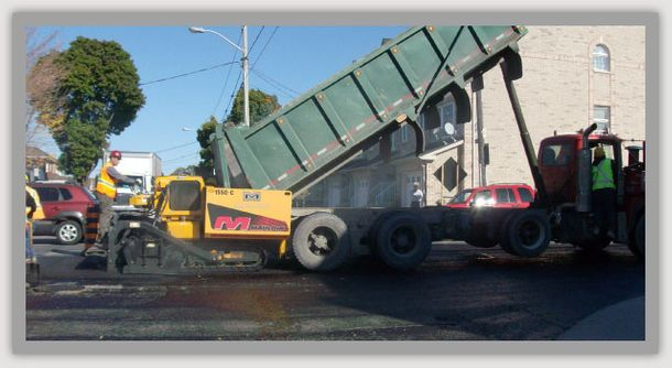 dumping asphalt directly into paver